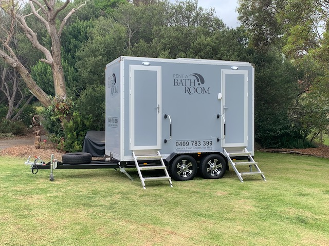 twin deluxe toilet hire outside